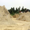 Sand piles on the Gale Briggs Inc property